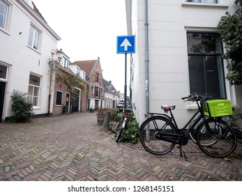 Amersfoort, Netherlands, 15 december 2018: bicycles parked in narrow medieval street in city of amersfoort in holland
