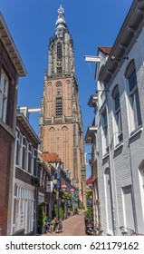 AMERSFOORT, NETHERLANDS - APRIL 09, 2017: Narrow old street and church tower in Amersfoort, Holland