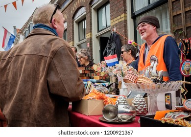 Amersfoort, the Netherlands - April 27, 2018 : Casual talk during the flee market on King's day in the Netherlands