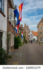 Amersfoort, the Netherlands - April 27, 2018 : People walking in the old city of Amersfoort on King's day