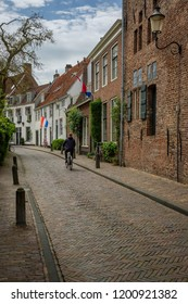Amersfoort, the Netherlands - April 27, 2018 : Cyclist in the streets of the old city of Amersfoort on King's day