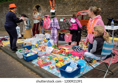 Amersfoort, the Netherlands - April 27, 2018 : Mothers and daughters selling their old toys and clothes on the flee market on King's day