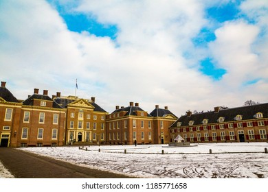 Amersfoort, The Netherlands - February 12, 2012: Het Loo palace and front garden with snow on a cold winter day