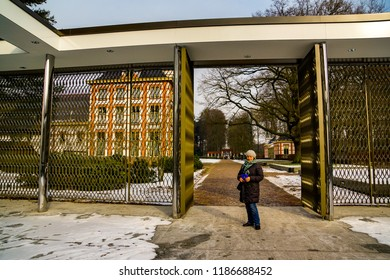 Amersfoort, The Netherlands - February 12, 2012: Woman standing in front of a open gate of the Het Loo palace on a cold winter day
