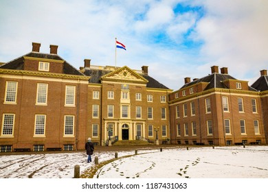 Amersfoort, The Netherlands - February 12, 2012: Het Loo palace with Dutch flag on top on a cold winter day with snow