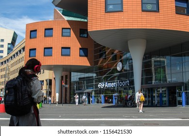 AMERSFOORT, NETHERLANDS; JULY 2018 A girl standing front of Amersfoort train station,Netherlands.