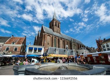 AMERSFOORT, NETHERLANDS; July 2018 Sint-Joriskerk at center of Amersfoort with toursit, Netherlands.
