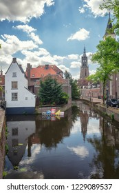 Amersfoort, Netherlands, May 17, 2015: Impression of city of Amersfoort in The Netherlands with the Onze Lieve Vrouwetoren in the background and floating modern art in the cana
