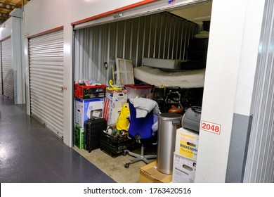 Amersfoort, the Netherlands,June,20,2020:Indoor storage unit with open door and household goods in a self storage facility. Rental Storage Units