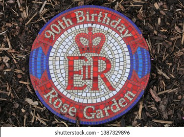 Amersham, Buckinghamshire, England, UK. April 26, 2019.  A blue red and white circular mosaic plaque in the rose garden to commemorate Queen Elizabeth II 's 90th birthday.