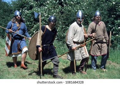 Amersham Buckinghamshire UK 2001. Unidentified reenactors of the Dark Age period wear the clothing and armour of  Anglo Saxon Warriors they walk through woodland as a raiding party.