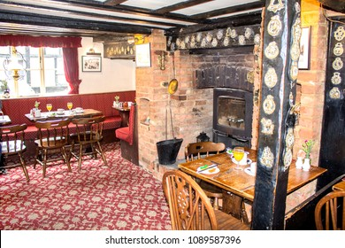 "Amersham, England - July 14, 2017: The interior of the historical pub in the hotel ""Saracens Head Inn"". Traditional English style. Ancient building, 17th century. Retro."