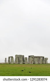 AMESBURY, GREAT BRITAIN - DEC 23, 2018: The stone monument Stonehenge a cloudy day, built in the late Neolithic period, around 2500 BC for unknown reason. December 23, 2018 in Amesbury, Great Britain