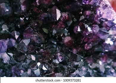 Amethyst crystal geode texture, purple crystal background. gemstone reiki healing meditation stone