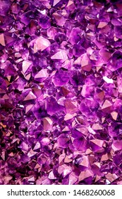 Amethyst purple crystal. Mineral crystals in the natural environment. Texture of precious and semiprecious gemstone
