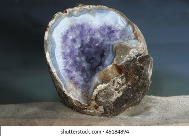 Ametyst geode in the blue agate shooted under water