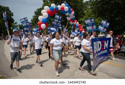 Amherst, N.H./USA - July 4, 2019: Joe Biden supporters march with signs in the Amherst July 4th parade.