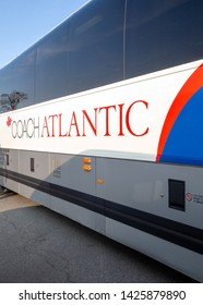 Amherst, Nova Scotia, Canada - May 30 2019: Buses from MaritimeBus (Coach Atlantic Group) are waiting for customers to go to Halifax, Moncton and Charlottetown in Atlantic Canada in the sunset
