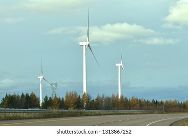 Amherst, Nova Scotia / Canada - November 20 2016:  View of Wind Turbines in Motion Along the Highway