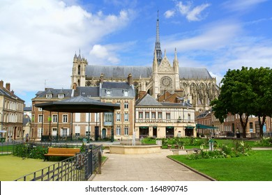 AMIENS, FRANCE - AUGUST 11: downtown glimpse  and Our Lady of Amiens Cathedral on August 11, 2013 in Amiens, France. The Cathedral was built between 1220 and 1266 and it's the biggest in France.