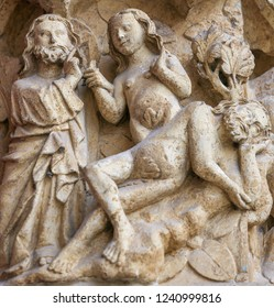 Amiens, France - February 9, 2013: Sculpture at the famous Gothic Cathedral of Amiens, France, depicting the Creation of Eve from the rib of Adam.