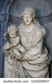 Amiens, France - February 9, 2013: Sculpture of Madonna and Child at the famous Gothic Cathedral of Amiens, France,