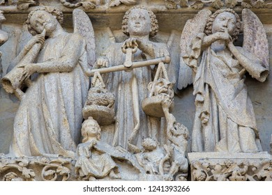 Amiens, France - February 9, 2013: Sculpture at the famous Gothic Cathedral of Amiens, France, depicting the Last Judgement