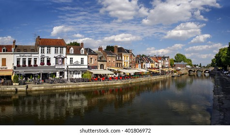 AMIENS, FRANCE - JULY 30, 2010: Waterfront canal in Amiens. Amiens is a historical city in northern France, 120 km (75 mi) north of Paris. It is the capital of the Somme department in Picardy.