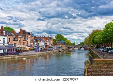 Amiens, France - May 9, 2012: Quay of Belu with traditional houses and Somme River in Amiens, Picardy, France. People on the background
