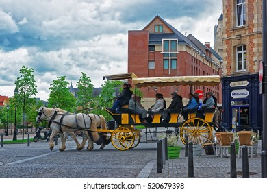 Amiens, France - May 9, 2012: Horse Carriage with tourists in the city center of Amiens, Picardy in France.