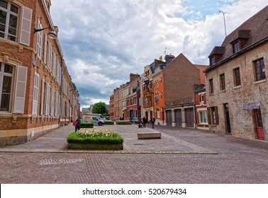 Amiens, France - May 9, 2012: Street with people in the old town of Amiens, Picardy in France.