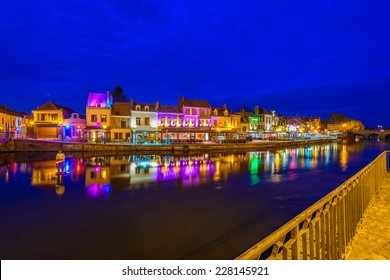 Amiens, Paris, France at night. Beautiful view at the restaurants and cafe at the bench of the river.