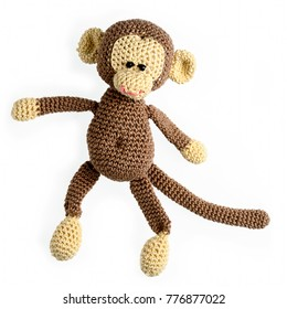 amigurumi crocheted monkey toy isolated on white background