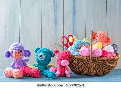 Amigurumi toys on a wooden background