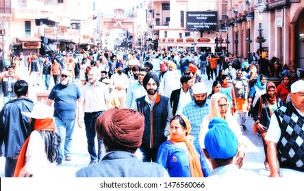 Amiritsar Punjab, India - 12 March 2019: Tourists and pilgrims through the polluted streets of Amritsar. Amritsar is a city in northwestern India located in the state of Punjab.