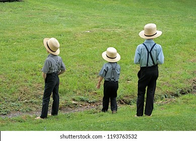 Amish Boys by a stream, Lancaster PA