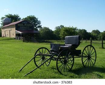 amish buggy with barn in background