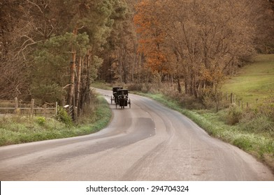 Amish buggy coming down country road in Ohio