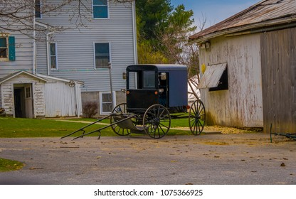 Amish buggy parked outside the barn