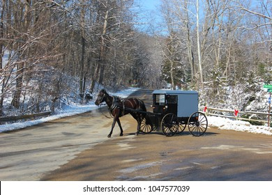 Amish buggy travels on a road on a bitterly cold December morning in Park County, Indiana.