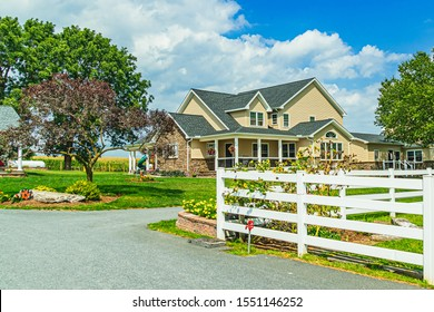 Amish country homes and barns in Amish Country field agriculture farm barn in Lancaster, PA US