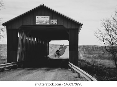 Amish horse and buggy over an Ohio covered bridge