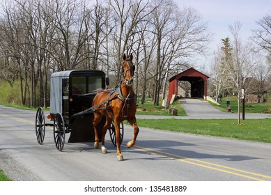 An Amish horse and carriage travels on a rural road in Lancaster County,Pennsylvania.