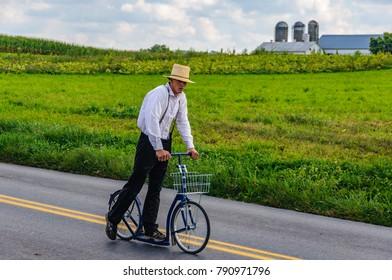 AMISH PENNSYLVANIA, USA - SEPTEMBER 16, 2017: Boy riding a roller bike in Amish Country in Pennsylvania, USA