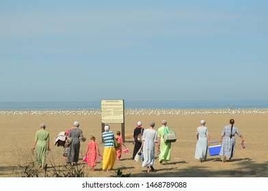 Amish Women and Children Picnic At The Beach