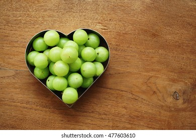 amla green fruits on wooden background.