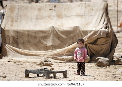 AMMAN, JORDAN, 14 JUNE 2015, A syrian refugee child in front of his tent in Zaatari refugee camp.