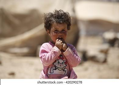 AMMAN, JORDAN, 14 JUNE 2015, A syrian refugee child in front of his tent in Zaatari refugee camp.