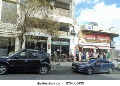 AMMAN, JORDAN - FEBRUARY 13 2018: Buildings and streets of Amman, the capital and most populous city of Hashemite Kingdom of Jordan. Western Asia. East Bank of the Jordan River