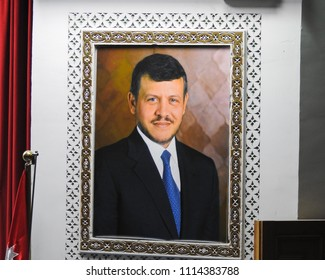 AMMAN, JORDAN - FEBRUARY 13 2018: Abdullah II bin Al-Hussein portrait inside the Hall for royal conferences. King Abdullah I Mosque in Amman